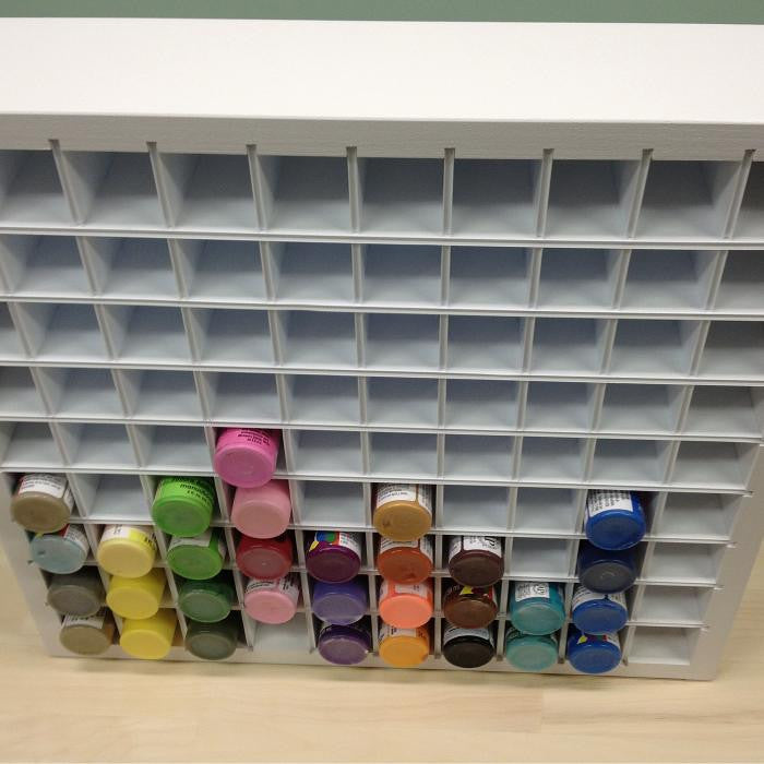 An above view of the Acrylic Paint organizer and shows a few paint bottles.