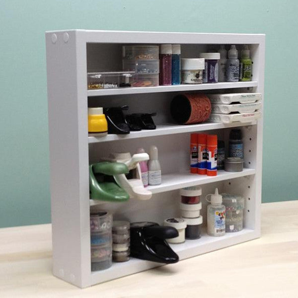 Adjustable Shelf Organizer main view photo with glitter and paper punches.