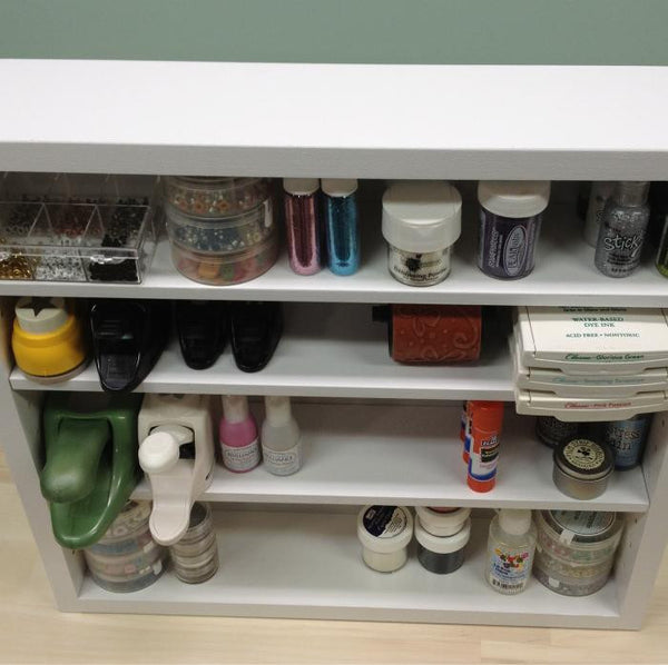 An above view of the Adjustable Shelf Organizer and shows craft items.
