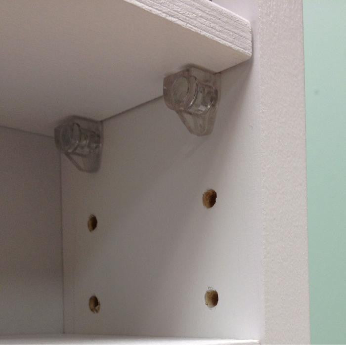 A picture close up showing how the shelves are adjustable with the pegs.
