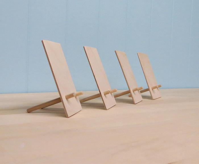 Side view of four card easels.