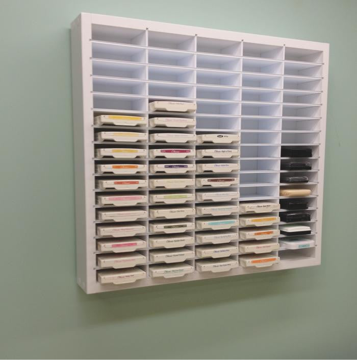 Pro Ink Organizer hanging up on the wall as if in a craft room.