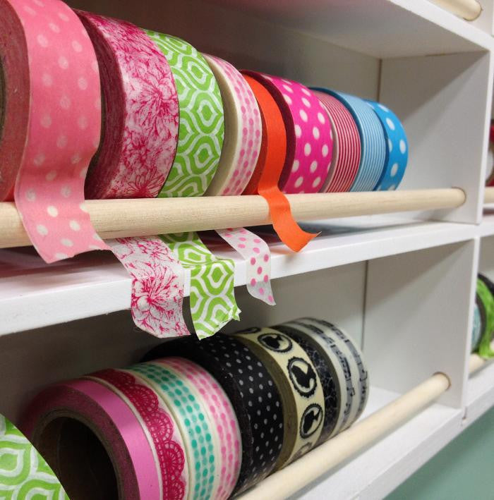 A close up picture of the Washi Tape Organizer and showing all the washi tape with the dowel.