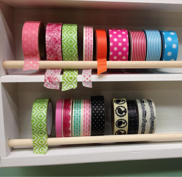 A close up of two cubbies. Both have washi tape displayed.