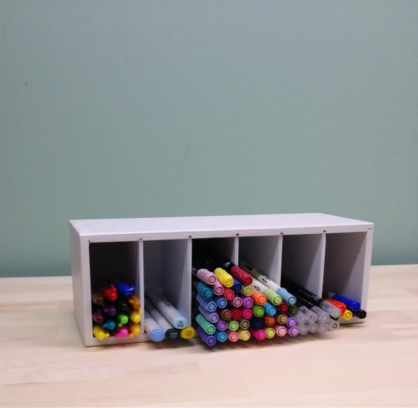 The Compact Marker organizer lying on its side horizantally showing that it can be stored on a craft desk or shelf like this.