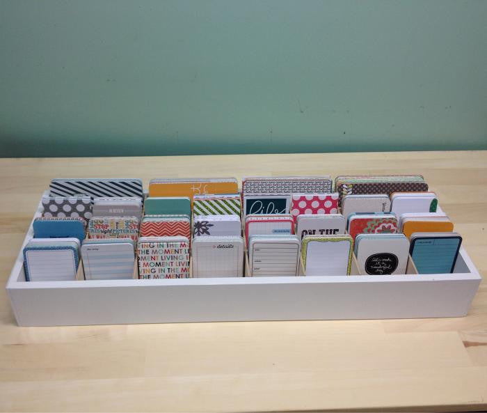 An above view of the journaling cards organized in every cubby.