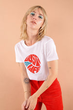 Meet our Lust for life white organic cotton slogan t-shirt, inspired by Iggy pop. This Psychedelic 60s retro design also features lyrics from Iggy Pop The Passenger. Satisfy your nostalgic soul with this vintage style t-shirt featuring retro red and blue colours. Support sustainable slow fashion and independent brands with every Fanclub clothing piece.