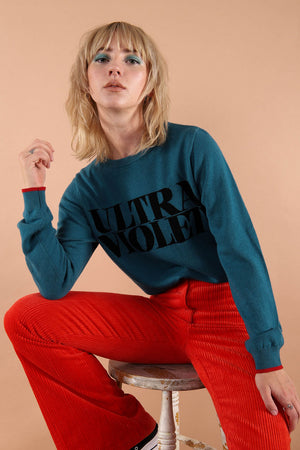 100% merino wool fine knit slogan jumper. Intarsia Ultra Violet slogan inspired by Andy Warhols superstars. Our retro colours pop and the super soft luxury knitwear supports slow sustainable fashion and independent brands.