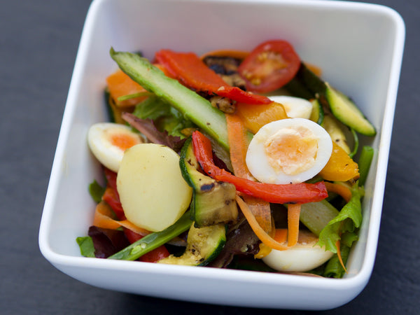 Mixed salad with quail eggs and seasonal vegetables