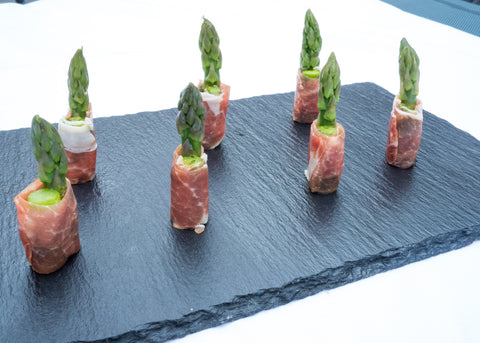 Asparagus wrapped in Parma ham with a hint of pesto