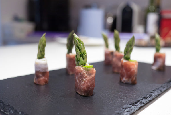 Asparagus wrapped in Parma ham with a touch of pesto