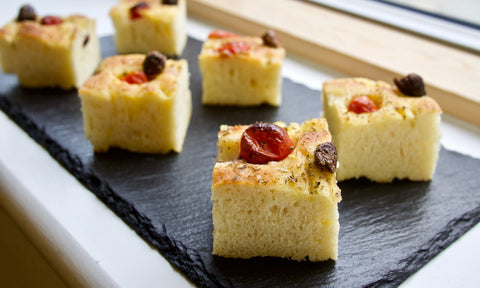 Focaccia with tomatoes, olives and oregano