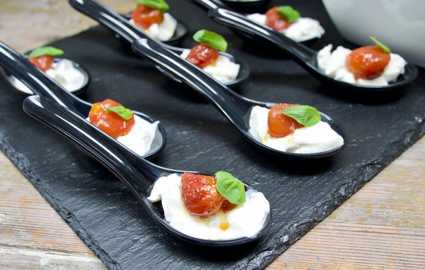 Stracciatella and confit tomatoes on the spoon