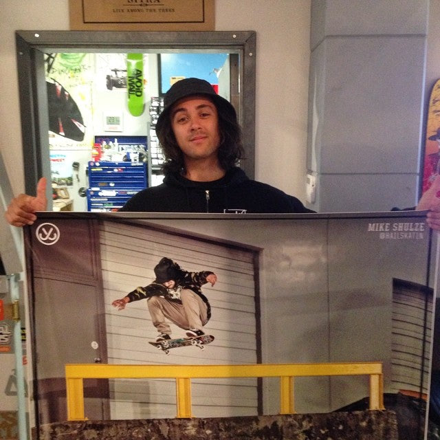 mike schulze aka @hailskat1n holding up his own @jslv poster. copy's available to pick up in shop #jslv #nolliefs180