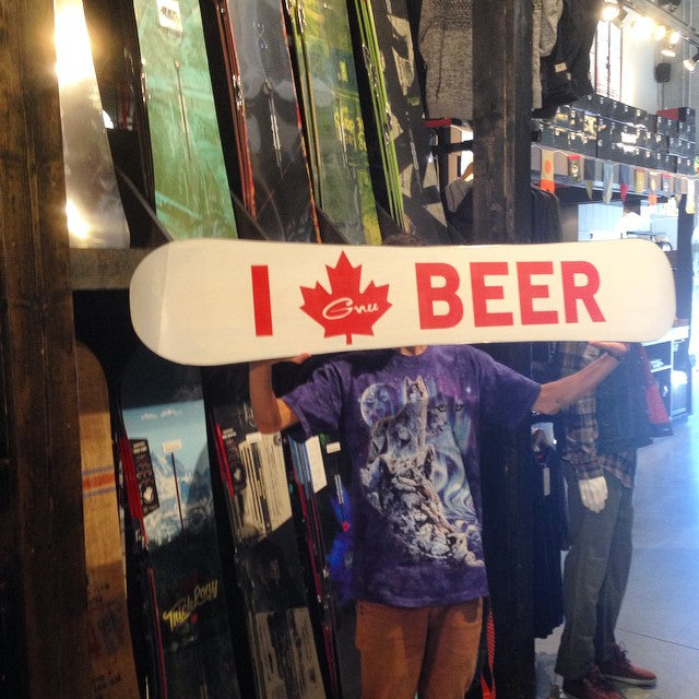 new 2015 @gnusnowboards hi 5 #canada board in shop. how dope is that base graphic!! @tysonbrunton holdin it up in front of a slew of new 2015 @burtonsnowboard. come see what we got! #beer