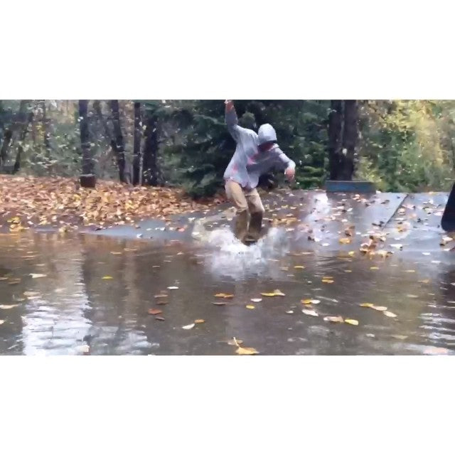 coastal staff up in whistler for the day. @theratchetwrangler kick flip into surf #staffouting #rainboarding #puddles