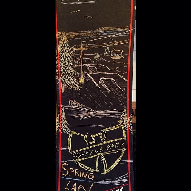 @zach_janz showing off his art skills on the @burtonsnowboard #chalkboard. @mtseymour #seymourreport #springlaps