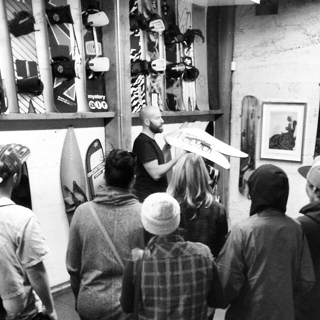 @scottserfas showing his collection of vintage boards to the crew last night. a trip through snowboard history in his photo studio at the endeavor office. #regram from @endeavorsnow #supportlocal