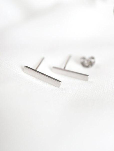 silver bar studs, side view