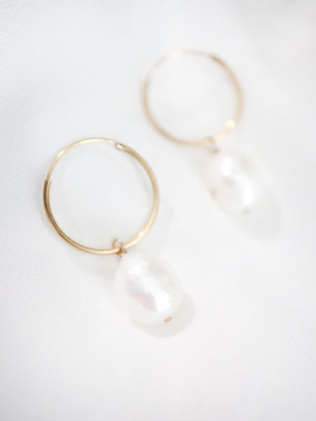 close up of baroque pearl hoops