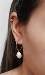 baroque pearl hoops modelled side view
