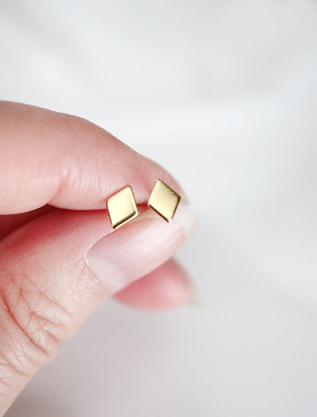 gold filled diamond stud earrings in hand