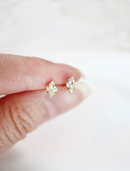 tiny crystal diamond stud earrings in hand