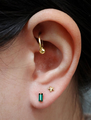 micro emerald baguette studs modelled, may birthstone