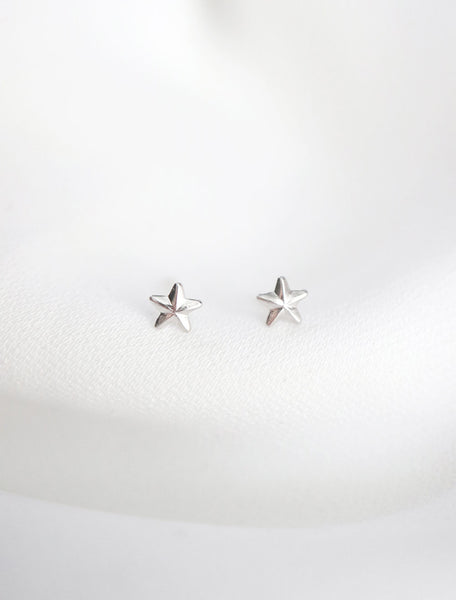 sterling silver micro star stud earrings