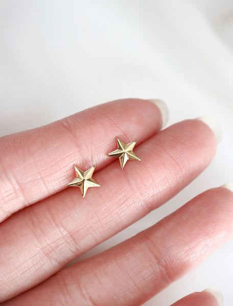 gold filled star stud earrings in hand