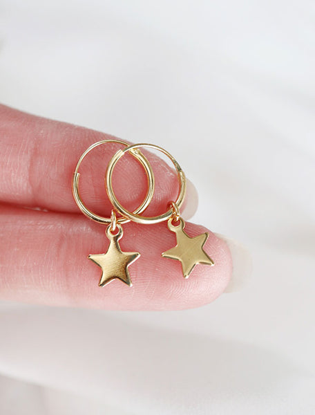 gold vermeil star charm hoops in hand