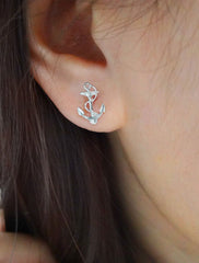 silver anchor stud earrings on model