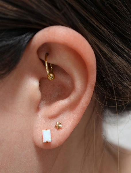 faceted opal baguette studs modelled