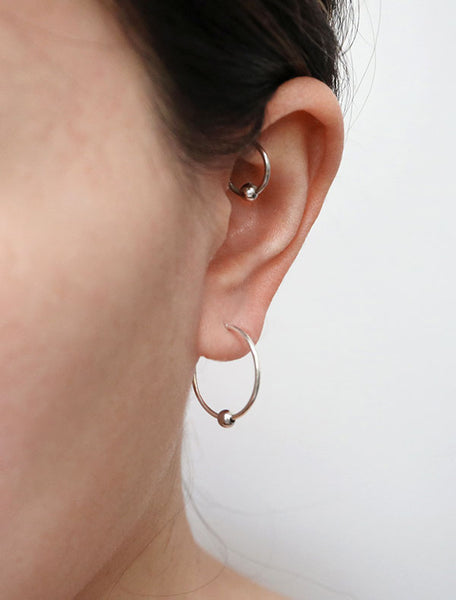 large sterling silver huggie hoop earrings with bead modelled