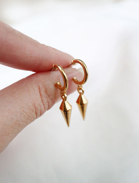 gold vermeil spike drop earrings in hand