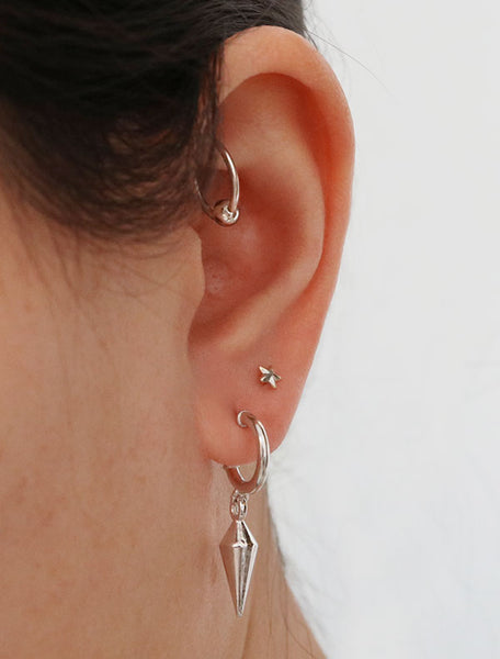 silver spike charm hoop stud earrings modelled
