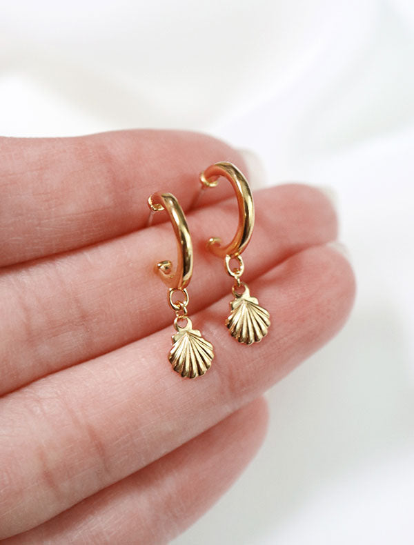 gold vermeil seashell charm hoop earrings in hand