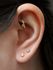 tiny gold vermeil moon studs modelled