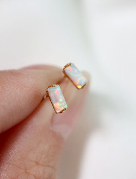 tiny opal baguette earrings close up
