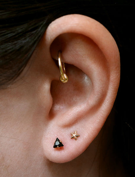 tiny black triangle studs modelled