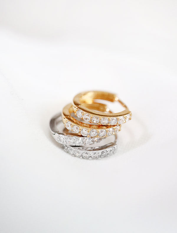 pave huggie hoop earrings in gold and silver
