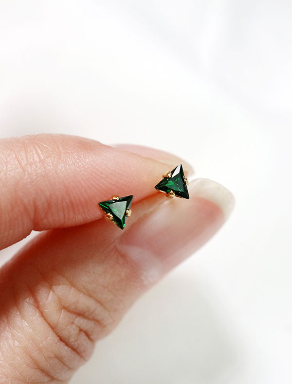tiny emerald triangle stud earrings in hand, may birthstone