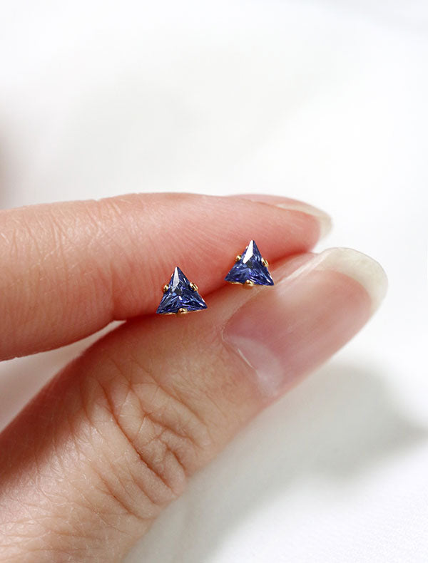 tiny sapphire triangle stud earrings in hand, september birth stone