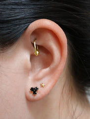 black crystal trefoil stud earrings modelled