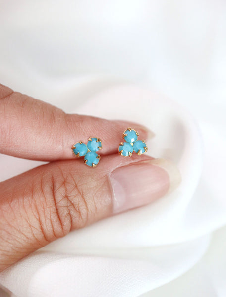 gold filled turquoise trefoil stud earrings in hand