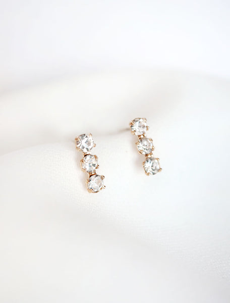 crystal triple bar stud earrings close up