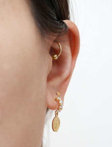 pave virgin mary hoop earrings modelled side view