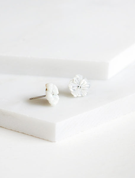 side view of carved mother of pearl flower studs