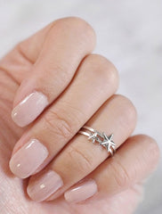 stacked large and small star midi rings