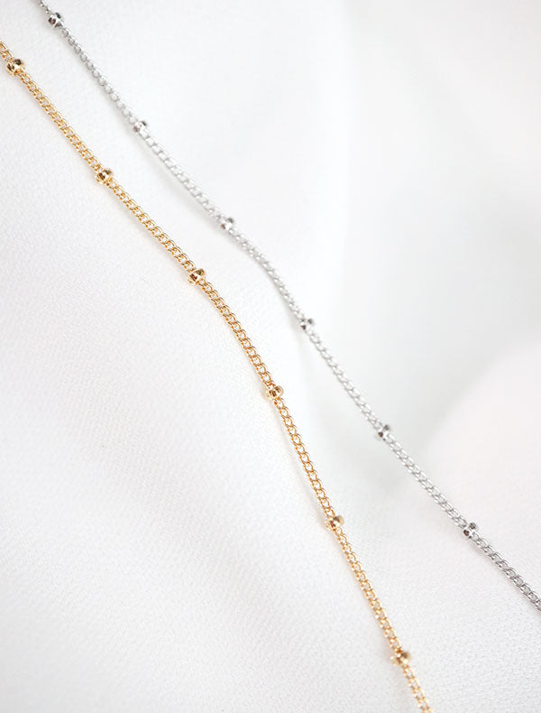 gold and silver satellite chain